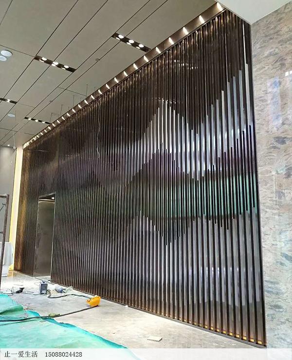 商业广场内墙壁竖条镂空不锈钢装饰效果图