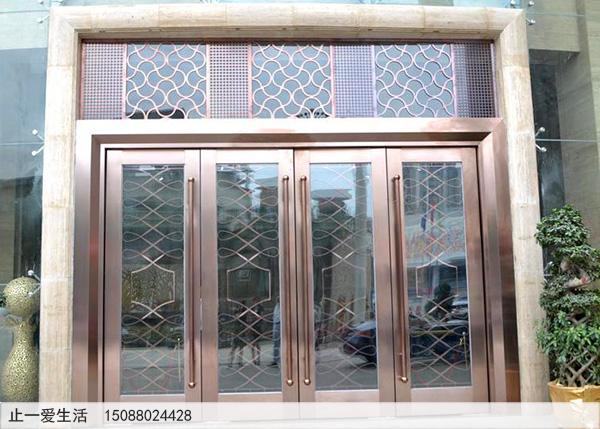 拉丝古铜酒店大门不锈钢镂空花格门头花效果图