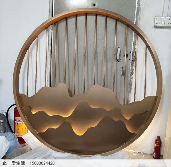 圆形带灯光的山形不锈钢屏风成品图